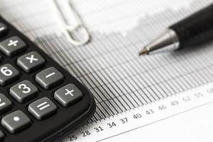 Closeup of a calculator and pen